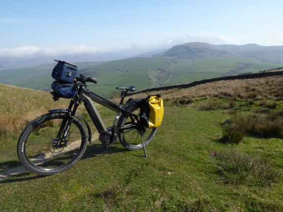E-biking on the Pennine Bridleway heading towards Kinder Scout